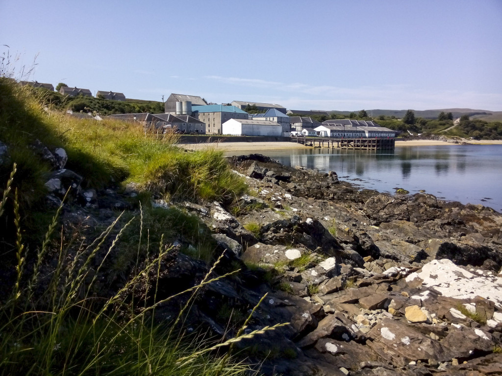 Whisky in pictures: Bunnahabhain Distillery seen from the beach on a beautiful summer day in 2014