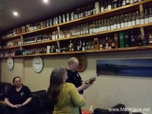 Erik and Jo browsing the whisky selection under the watchful eye of Fiona (left)