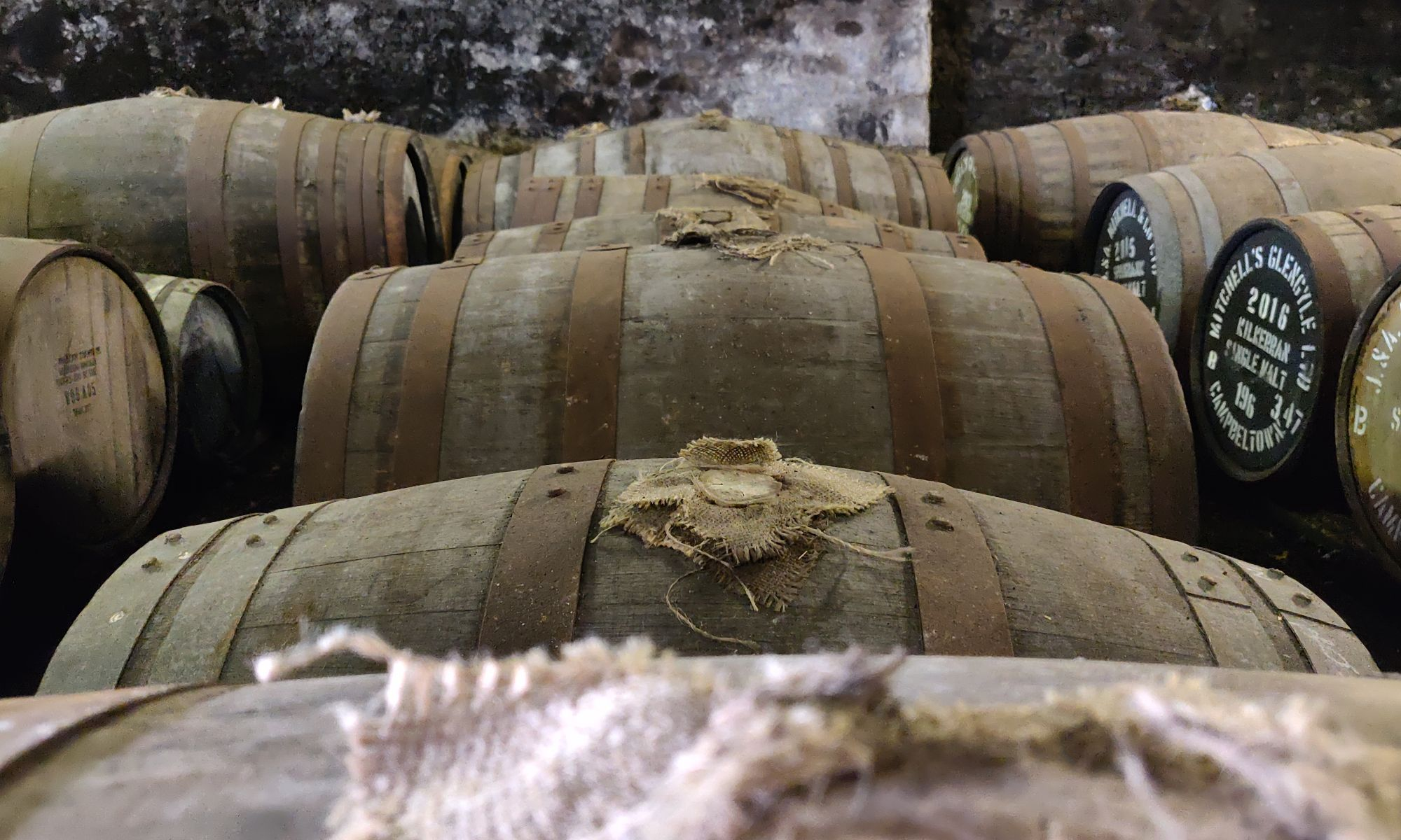 Casks in a whisky warehouse at Springbank distillery, Scotland